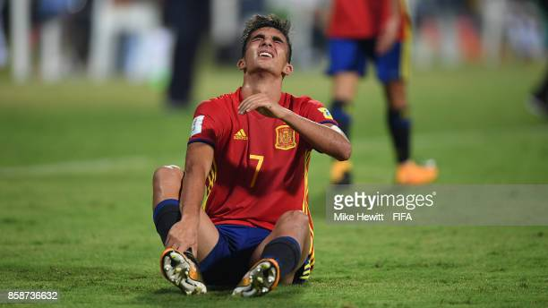 Ferran Torres of Spain feels the forec of a tackle during the FIFA U17 World Cup India 2017 group D match between Brazil and Spain at the Jawaharlal...