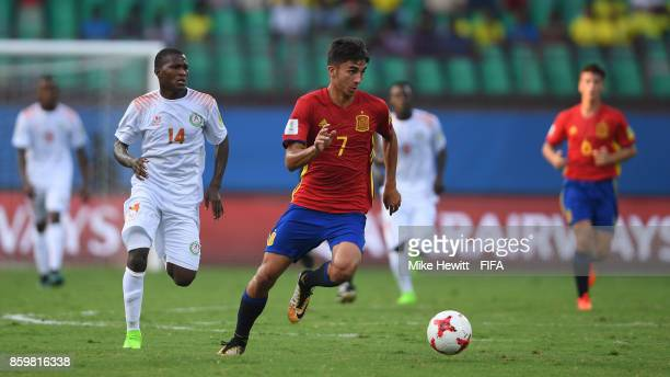 Ferran Torres of Spain gets away from Kader Aboubacar of Niger during the FIFA U17 World Cup India 2017 group D match between Spain and Niger at the...