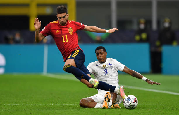 Ferran Torres of Spain is challenged by Presnel Kimpembe of France during the UEFA Nations League 2021 Final match between Spain and France at San...