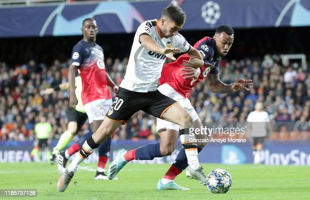 Ferran Torres of Valencia battles for possession with Gabriel of Lille during the UEFA Champions League group H match between Valencia CF and Lille...