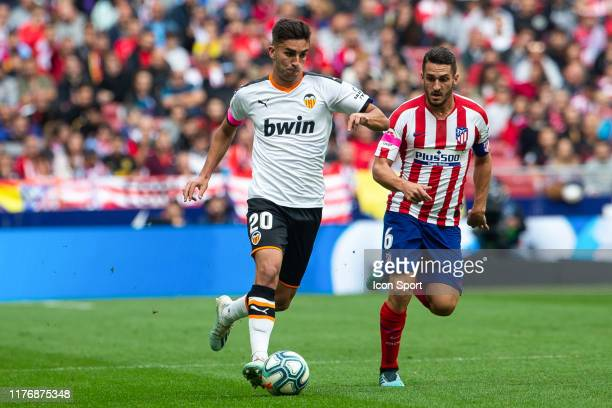 Ferran TORRES of Valencia CF and KOKE of Atletico de Madrid during the Liga match between Atletico de Madrid and Valencia at Wanda Metropolitano on...