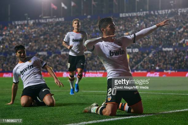 Ferran Torres of Valencia CF celebrates his side's fourth goal with his teammate Carlos Soler of Valencia CF during the Liga match between Levante UD...