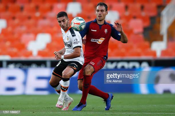 Ferran Torres of Valencia CF challenges for the ball against Unai Garcia of CA Osasuna during the Liga match between Valencia CF and CA Osasuna at...