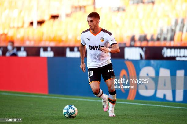 Ferran Torres of Valencia CF runs with the ball during the Liga match between Valencia CF and Athletic Club at Estadio Mestalla on July 01 2020 in...