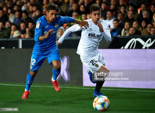 Ferran Torres of Valencia competes for the ball with Damian Suarez of Getafe during the Copa del Rey Quarter Final second leg match between Valencia...