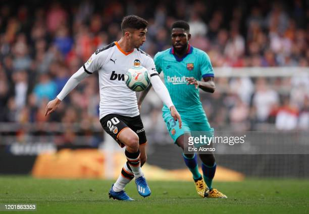 Ferran Torres of Valencia is closed down by Samuel Umtiti of FC Barcelona during the La Liga match between Valencia CF and FC Barcelona at Estadio...