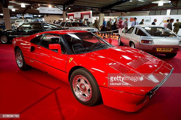 Ferrari 288 GTO in The 'Earls Court Motor Show' building at the Goodwood Revival Meeting 12th Sept 2014