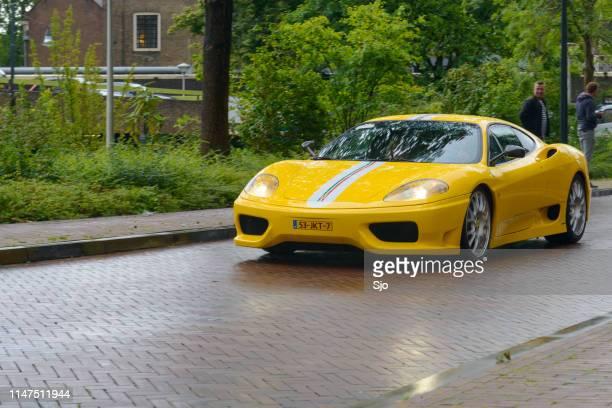Ferrari 360 Modena Challenge Stradale sports car in the rain