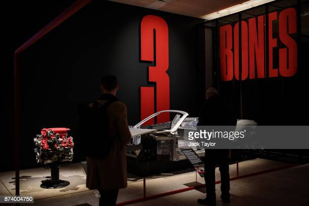 Ferrari 488 GTB eight Cylinder engine 2015 and a the chassis for a Ferrari 458 Spider 2011 on display at the 'Ferrari Under the Skin' exhibition at...