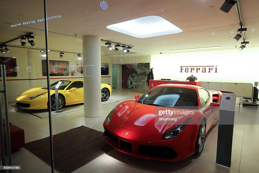 A Ferrari 488 GTB, right, and a Ferrari 458 Italia, luxury sportscar sit on display in the Ferrari SpA automobile dealership on Tretyakov Drive in Moscow, Russia, on Wednesday, Dec. 28, 2016. President-elect Donald Trump said Wednesday that the U.S. should move on rather than retaliate against Russia for interfering in the 2016 election, with the Obama administration expected to soon take action against Moscow. Photographer: Andrey Rudakov/Bloomberg via Getty Images