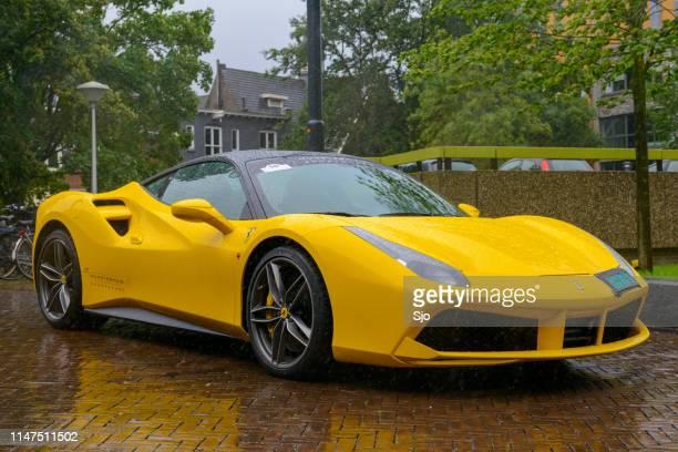 Ferrari 488 GTB sports car in the rain