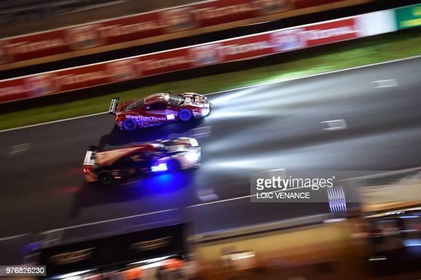 Ferrari 488 GTE German driver Lucas Stolz competes during the 86th Le Mans 24hours endurance race at the Circuit de la Sarthe at night on June 17...