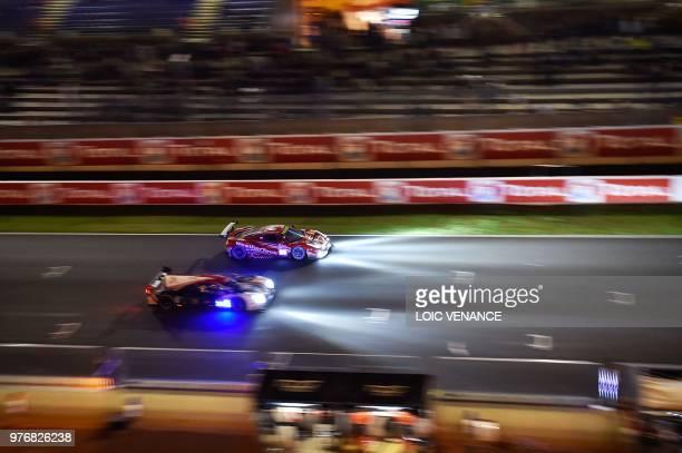 TOPSHOT Ferrari 488 GTE German driver Lucas Stolz competes during the 86th Le Mans 24hours endurance race at the Circuit de la Sarthe at night on...