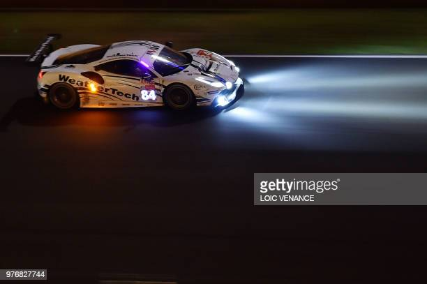 Ferrari 488 GTE WEC US driver Cooper MacNeil competes during the 86th Le Mans 24hours endurance race at the Circuit de la Sarthe at night on June 17...