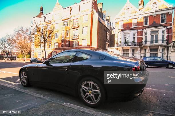 """ferrari 612 scaglietti gt sports car parked on the street in london uk - """"sjoerd van der wal"""" or """"sjo"""" stock pictures, royalty-free photos & images"""