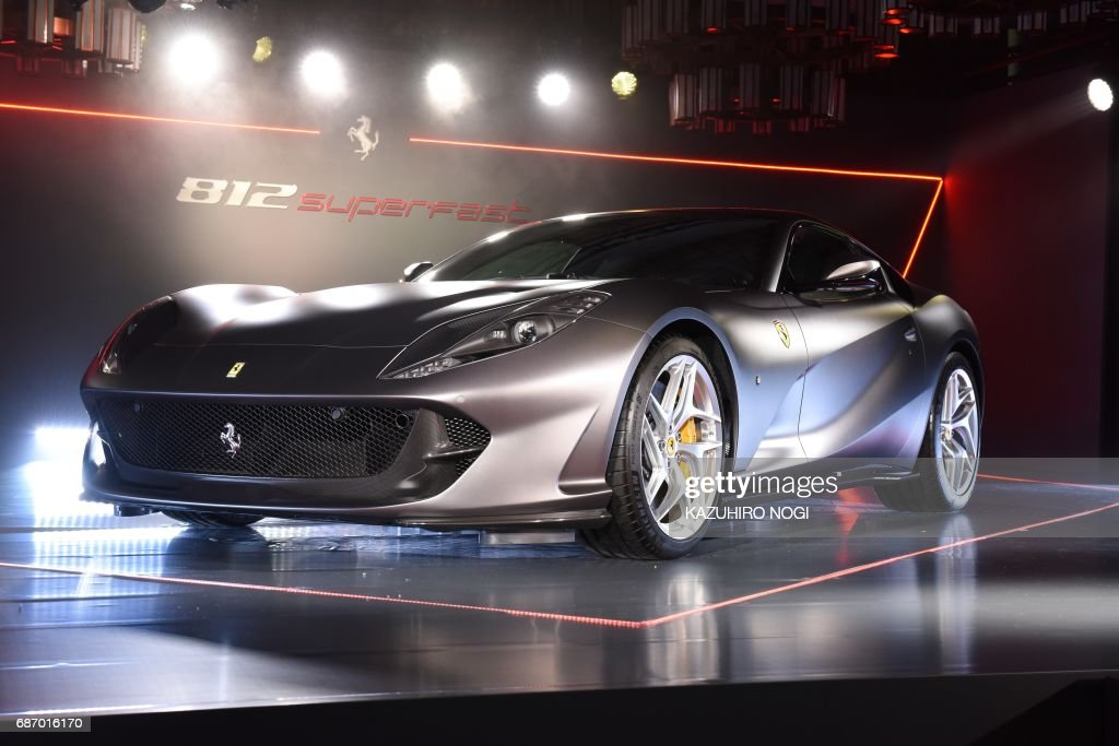 A Ferrari 812 Superfast is diplayed at a press conference for Japanese media in Tokyo on May 23, 2017. The 812 Superfast made its debut at the Geneva Motor Show in March 2017. / AFP PHOTO / Kazuhiro NOGI