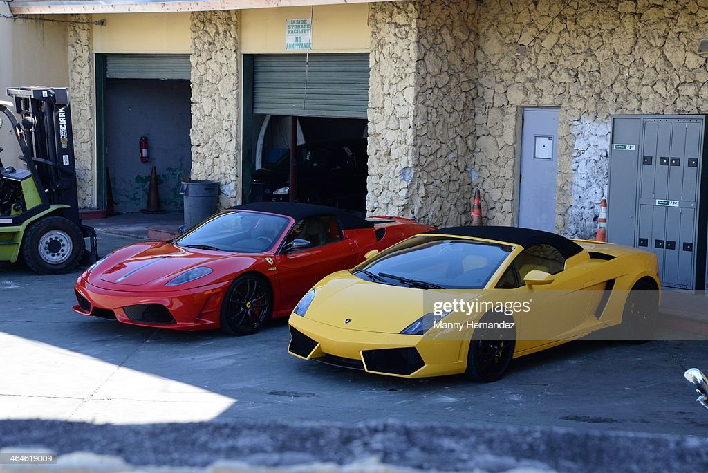 Ferrari and Lamborghini cars believed to have been used by Justin Bieber during his road racing before he was arrested sit in an impound lot on January 23, 2014 in Miami Beach, Florida. Justin Bieber was charged with drunken driving, resisting arrest and driving without a valid license after Miami Beach Police found the pop star street racing on Thursday morning.