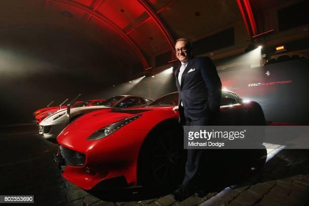 Ferrari Australia CEO Herbert Appleroth poses with a older model Ferrari before unveiling the new Ferrari 812 Superfast at the Australasian Premiere...