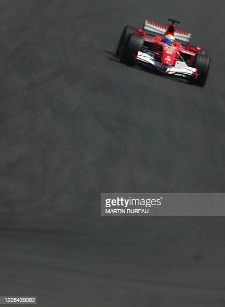 Ferrari Brazilian driver Felipe Massa steers his car on the Nevers Magny-Cours racetrack during the Grand Prix of France, 16 July 2006 in...
