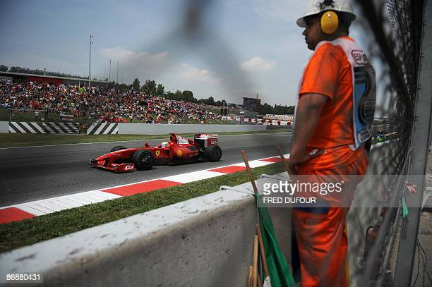 Ferrari Brazilian's driver Felipe Massa drives at the Circuit de Catalunya, on May 10, 2009 in Montmelo, near Barcelona, during the Formula One...