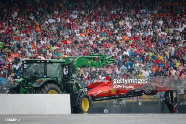 HOCKENHEIMRING HOCKENHEIM GERMANY Ferrari car of Monegasque driver Charles Leclerc is being towed away after crashing during the German F1 Grand Prix...