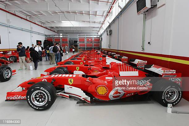 Ferrari cars are displayed in the Ferrari Formula 1 clients department during a Ferrari factory tour on July 19 2011 in Maranello Italy Ferrari SpA...
