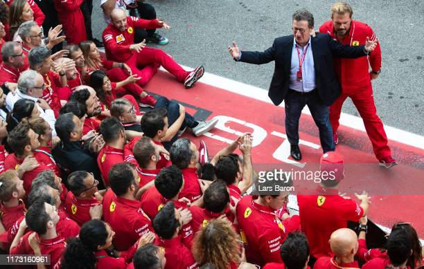 Ferrari CEO Louis C. Camilleri celebrates with the Ferrari team after the F1 Grand Prix of Italy at Autodromo di Monza on September 08, 2019 in...