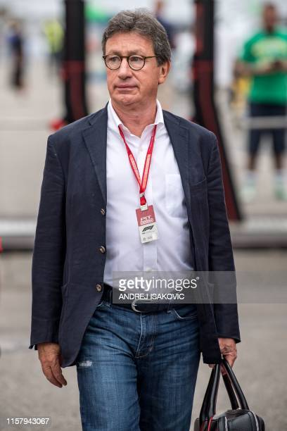Ferrari CEO Louis Camilleri walks down the paddock ahead of the third practice session of the German Formula One Grand Prix at the Hockenheim racing...