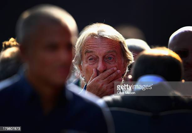 Ferrari Chairman Luca Cordero di Montezemolo is surrounded by the media as he arrives in the paddock prior to the final practice session before...