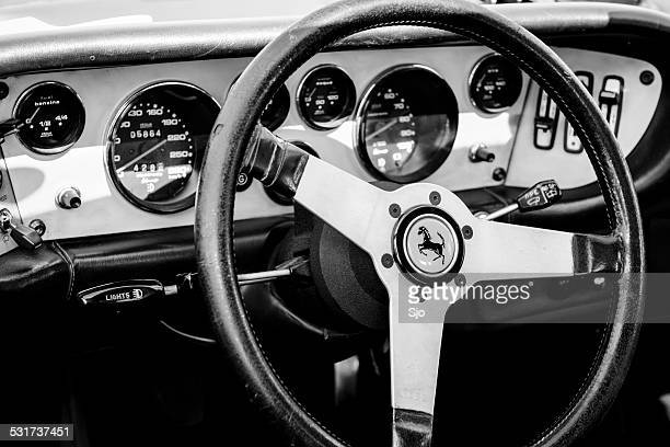 ferrari dino classic italian sports car dashboard in black white - ferrari stock pictures, royalty-free photos & images