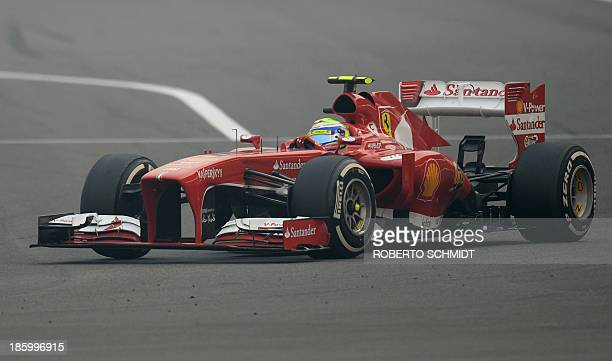 Ferrari driver Felipe Massa of Brazil drives his car during the Formula One Indian Grand Prix 2013 at the Buddh International circuit in Greater...