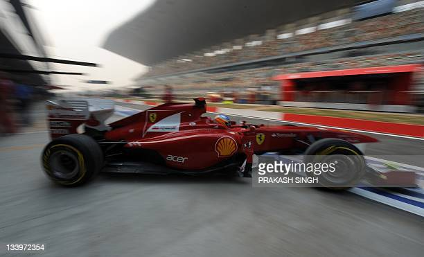 Ferrari driver Fernando Alonso of Spain drives out of the pit during the first practice session of Formula One's Indian Grand Prix at the Buddh...