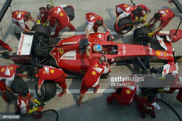 Ferrari driver Fernando Alonso of Spain enters the pit during the second practice session of the Formula One Malaysian Grand Prix at the Sepang...