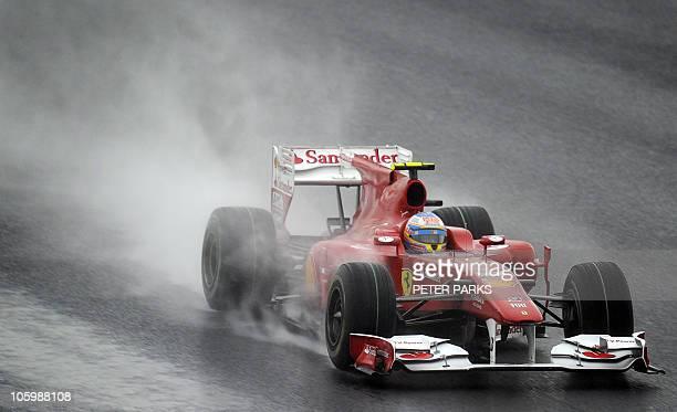 Ferrari driver Fernando Alonso of Spain pilots his car over a wet track during the South Korean Formula One Grand Prix at the Korean International...