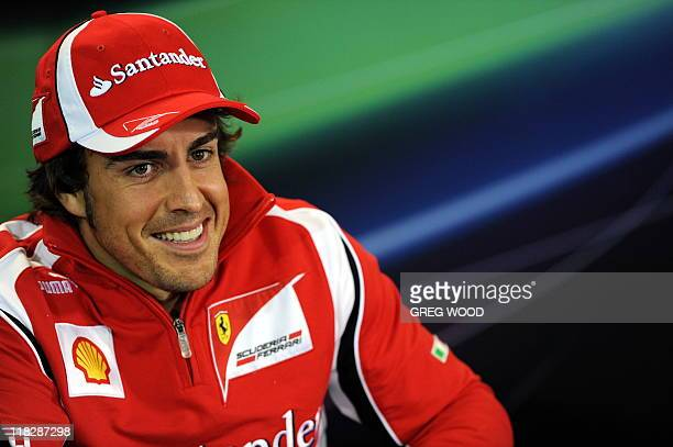 Ferrari driver Fernando Alonso of Spain smiles during a press conference on the eve of the first practice session for Formula One's Australian Grand...