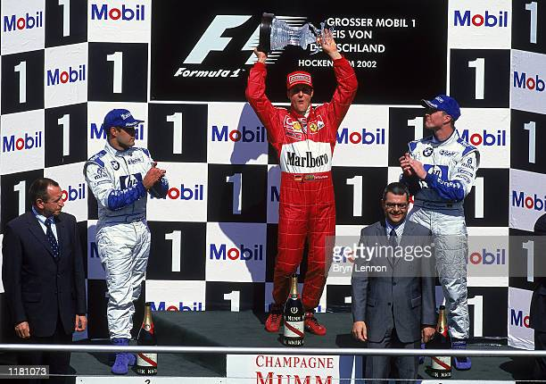 Ferrari driver Michael Schumacher celebrates on the podium after victory in the Formula One German Grand Prix at Hockenheim in Germany on July 28 2002