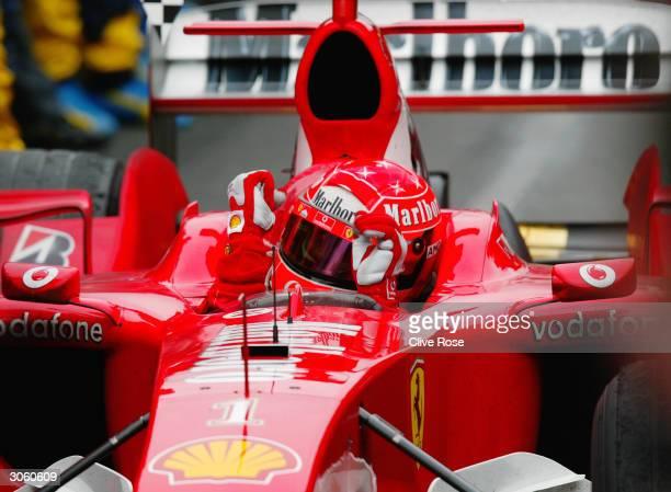 Ferrari driver Michael Schumacher of Germany and the Ferrari Formula One team celebrate after winning the 2004 F1 Australian Grand Prix held on March...