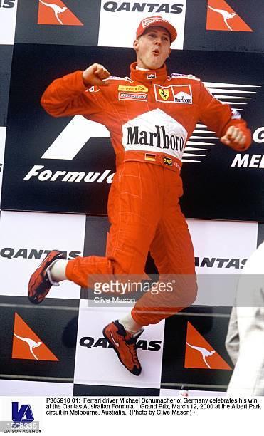 Ferrari driver Michael Schumacher of Germany celebrates his win at the Qantas Australian Formula 1 Grand Prix March 12 2000 at the Albert Park...