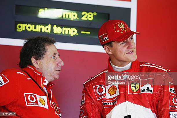 Ferrari driver Michael Schumacher of Germany chats to Ferrari Technical Director Jean Todt during the first practice for the Belgian Formula One...