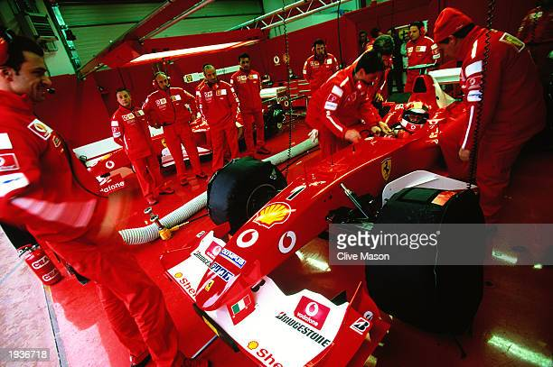 Ferrari driver Michael Schumacher of Germany in the garage during the Shell Ferrari Unbranded F2003GA F1 car testing session held on April 11 2003 in...
