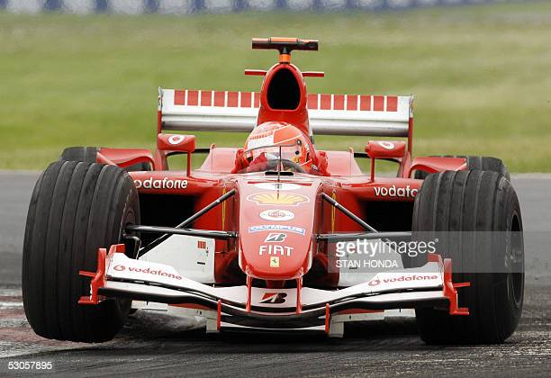 Ferrari driver Michael Schumacher of Germany lifts a tire as he goes through turn two on his way to a secondplace finish at the Formula One Grand...