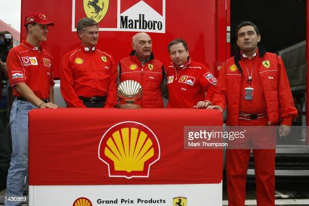 Ferrari driver Michael Schumacher of Germany, Shell Executive Vice-President of Marketing John Wills, Jose Froilan Gonzalez of Argentina, Jean Todt...