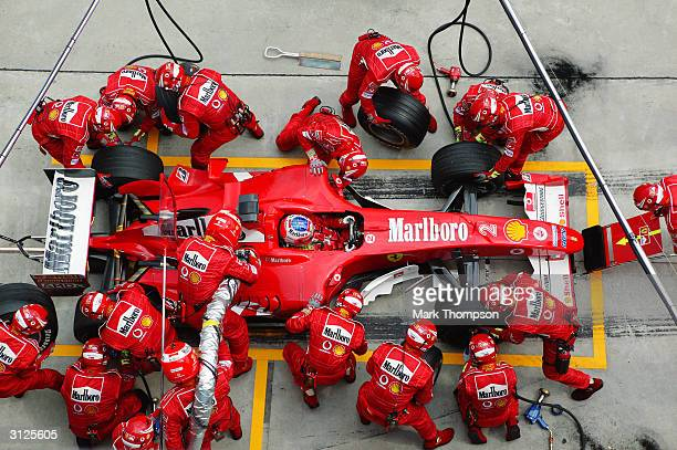 Ferrari driver Rubens Barrichello of Brazil comes in for a pitstop during the 2004 F1 Malaysian Grand Prix held on March 21 2004 at the Sepang...