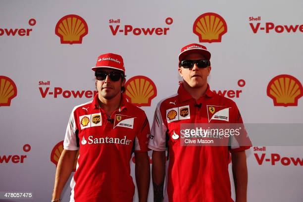 Ferrari drivers Kimi Raikkonen of Finland and Fernando Alonso of Spain arrive for a media call at the Backlot Studio during previews to the...