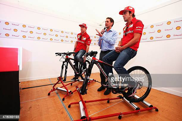 Ferrari drivers Kimi Raikkonen of Finland and Fernando Alonso of Spain take part in a pushbike challenge at the Backlot Studio during previews to the...