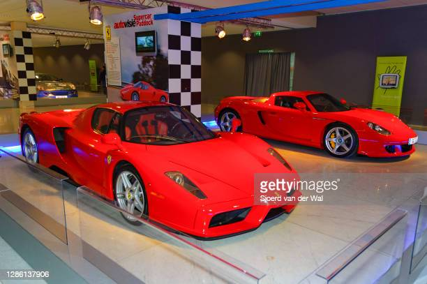 Ferrari Enzo and Porsche Carrera GT Supercars on display at Amsterdam motor show AutoRAI on February 9, 2005 in Amsterdam, The Netherlands.