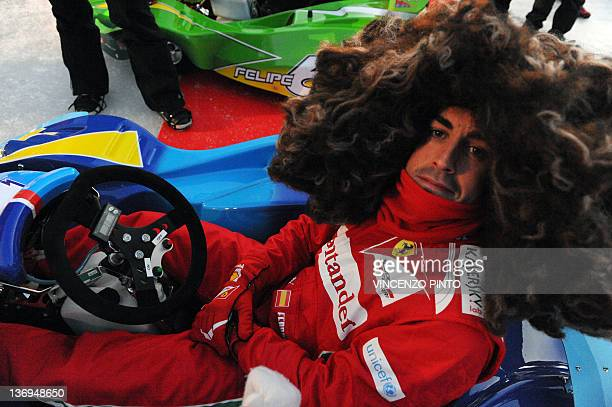 Ferrari F1 driver Spanish Fernando Alonso wearing a wig arrive poses prior to a kart race event on January 13 as part of the 'Wroom 2012 F1 and...