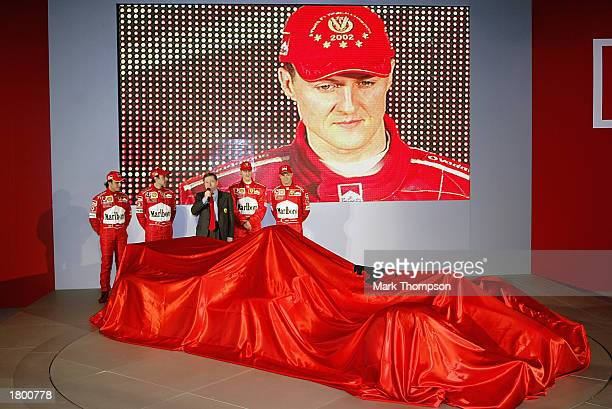 Ferrari F1 drivers Michael Schumacher of Germany and Rubens Barrichello of Brazil and test drivers Felipe Massa and Luca Badoer with technical...