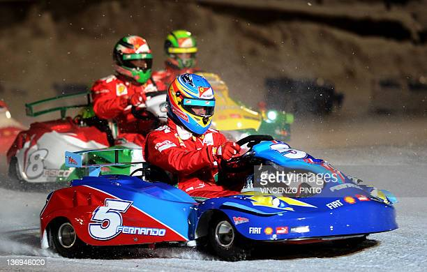Ferrari F1 Spanish driver Fernando Alonso competes during a kart race on January 13 2012 as part of the 'Wroom 2012 F1 and MotoGP Press Ski Meeting'...