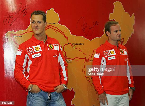 Ferrari F1 team drivers Michael Schumacher and Rubens Barrichello stand in front of China's map during a press conference to promote Ferrari at a...